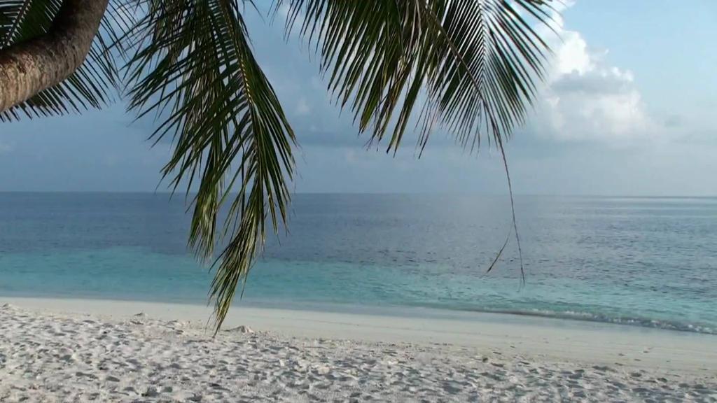Пляж острова Ихуру на Мальдивах, фото 8